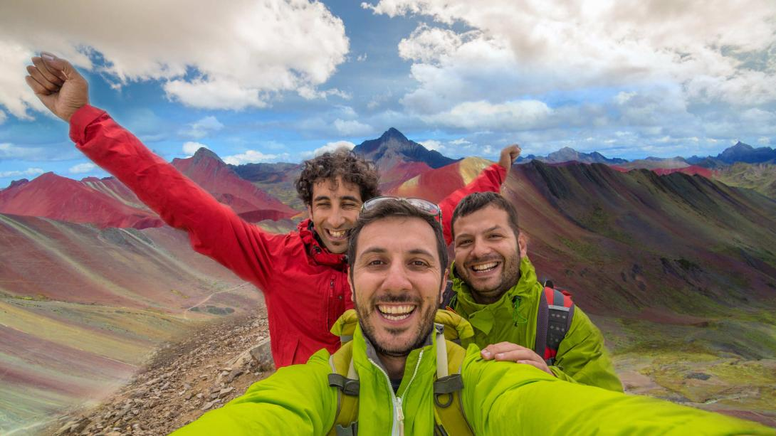 Hikers take a selfie in the Rainbow Mountains of Peru.